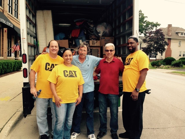 Caterpillar volunteers helping move a guest into a new place!